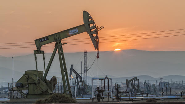 Pump jacks at the Belridge oil field in California's Kern County. Oil prices are expected to remain low in 2016 and economic growth is projected to pick up slightly, forecasters say.