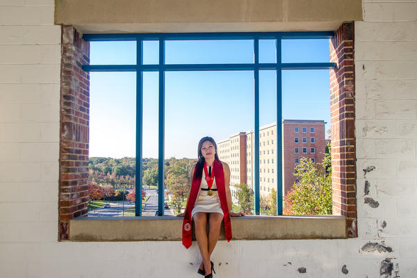 Karie Cheung poses for a graduation portrait at the University of Maryland in College Park, Md.