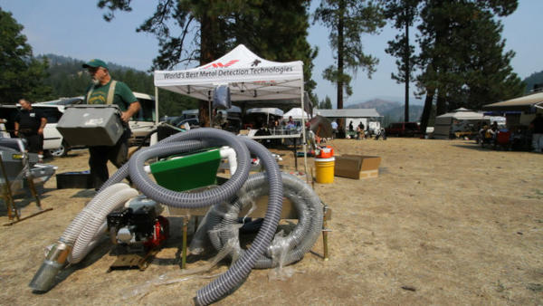 <p>At the annual Pacific Northwest Miner's Rally, gear providers hawk the latest dredging equipment. Suction dredges can retail for as much as $6000 but it's rare for miners to find more than $100 worth of gold in a day.</p>