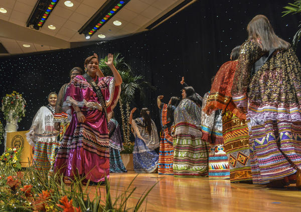 All twelve contestants in the Miss Florida Seminole Princess Pageant and Junior Miss Florida Seminole Princess Pageant, promenade across the stage, resplendent in their hand made patchwork garments.