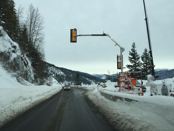 Temporary signals direct traffic in two spots where White Pass is reduced to one lane.