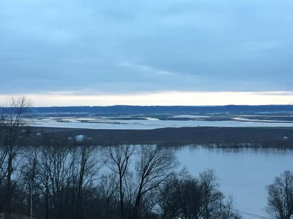 The Mississippi is extending across the bottom land at Chester, Ill., extending toward the bluffs east of Perryville, Mo. The bridge at Chester is closed, and the maximum-security Menard prison is threatened.