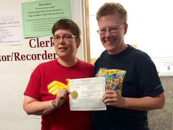 Tabitha Simmons (left) and Katherine Sprague received one of the first marriage licenses in Idaho in October.
