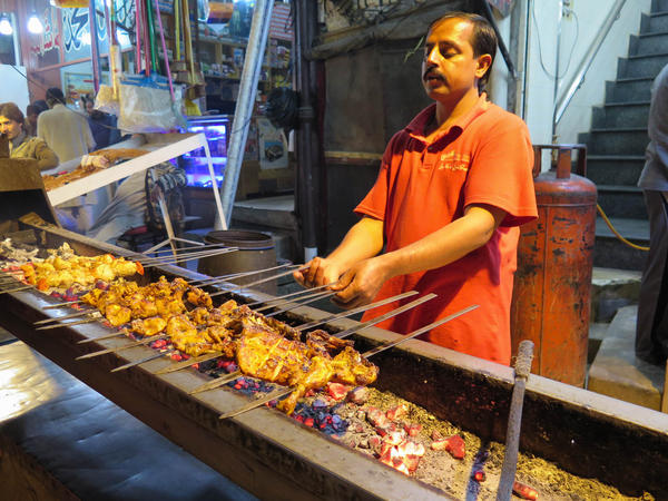 A chef cooks chicken in Lahore's Anarkali Food Street, a favorite eating place in a food-mad Pakistani city.