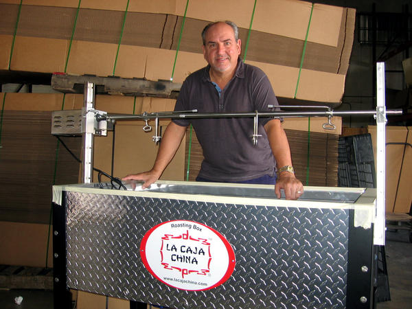 La Caja China CEO Roberto Guerra. Guerra says his father first spotted the wooden cooking boxes in Havana's Chinatown in 1955. In 1985, the two decided to re-create the devices, and La Caja China company was born.