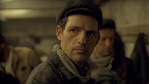 Saul (Géza Röhrig) is almost always seen in a near close-up in <em>Son of Saul</em>, putting you right there next to him.