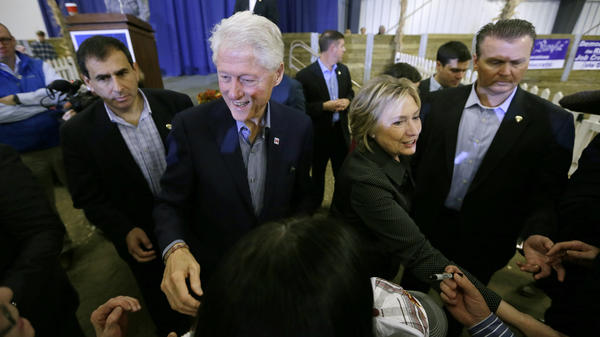 Bill and Hillary Clinton greet supporters at the Central Iowa Democrats Fall Barbecue in November. Bill Clinton is expected to have a greater presence on the campaign trail after the New Year.