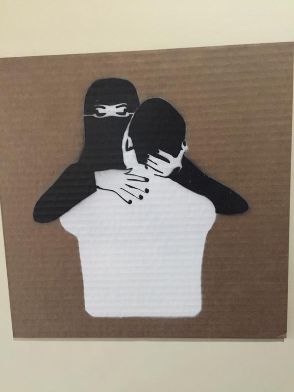 "A veiled woman and a man embrace in this work by Mohammed Labban at the recent art exhibition ""LoudArt,"" an annual event in the Saudi Arabian city of Jeddah. The exhibit, curated by a woman, often challenges conservative traditions in the kingdom."