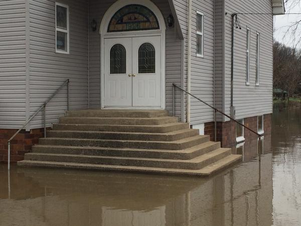 The Apostolic Church of Thebes, Illinois stands as flood waters fill its basement on Wednesday, Dec. 30, 2015.
