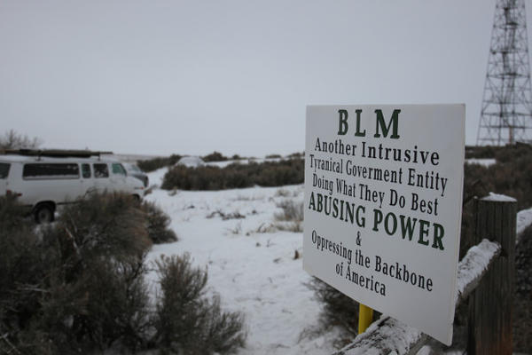 Protesters blocked the entrance to the refuge Sunday, hanging anti-government signs on the fenceposts.
