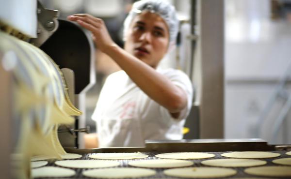 Tortillas being made at the El Milagro plant in San Marcos, Texas. The FDA is weighing whether to allow fortifying corn masa flour with folic acid, aka vitamin B9. The FDA currently bans the practice, but researchers say adding the vitamin to corn masa could help battle higher rates of severe neural tube defects among Hispanics.