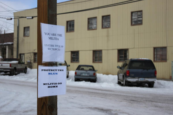 The prospect of hundreds of out-of-towners who openly carry firearms concern some in Burns. Fliers with the message ''Militia go home'' hang on signposts downtown.