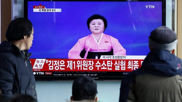 South Koreans watch a report on North Korea's TV announcement that it had successfully conducted a hydrogen bomb test. North Korea's neighbors have condemned the nuclear test, which is still being verified.
