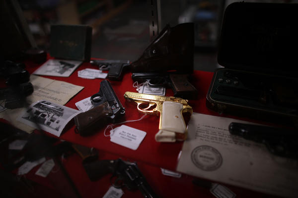 A gold pistol sits at the center of a display of rare and collectible handguns Tuesday at Northwest Armory in Portland, Ore. The high-end gun store sells handguns, hunting rifles and more to customers willing to go through a background check.