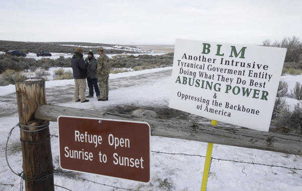"<p>Members of the group occupying the Malheur National Wildlife Refuge headquarters stand guard Monday, Jan. 4, 2016, near Burns, Ore. The group calls itself Citizens for Constitutional Freedom and has sent a ""demand for redress"" to local, state and federal officials. The armed anti-government group took over the remote national wildlife refuge in Oregon as part of a decades-long fight over public lands in the West.</p>"