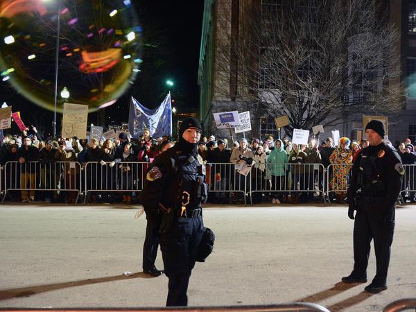 Police monitor protesters outside Thursday's Donald Trump campaign event in Burlington, Vt.