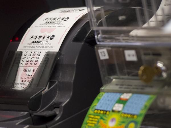 A machine prints Powerball lottery tickets at a convenience store in Washington, D.C. on Thursday. Saturday's jackpot has risen to $900 million.