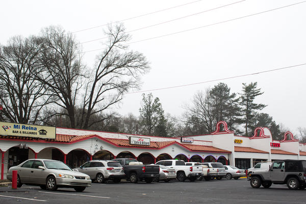 A strip mall sits just a block away from Central Avenue in East Charlotte, N.C.