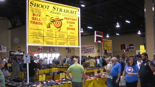 Attendees at a gun show in Miami have mixed feelings about Obama's executive actions.