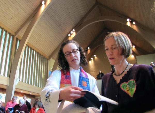 """<p>Abby Brockway (right), a member of the """"Delta 5,"""" sings with pastor Staci Imes at Woodland Park Presbyterian Church in Seattle. Brockway and four other activists face criminal charges for blocking BNSF Railway tracks in 2014.</p>"""