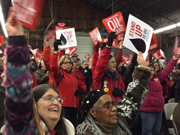 <p>Opponents of the proposed Vancouver Energy terminal dressed in red and held a rally during a break in the hearing Tuesday.</p>