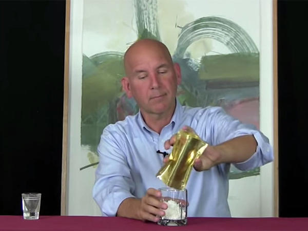 Palcohol creator Mark Phillips pours the powdered alcohol equivalent of one shot of vodka into a glass in a promotional video on the company's website.