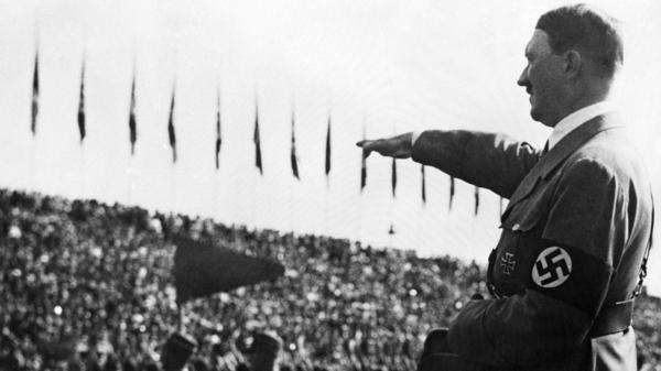Adolf Hitler gives the Nazi salute in Nuremberg, Germany, in 1935. Author Peter Ross Range says that Hitler's time in prison in 1924 helped pave the way for his rise to power.