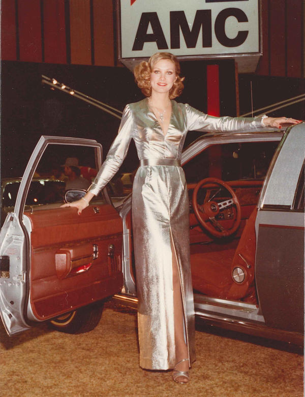 """One of Mitzel's outfits was a silver lamé dress. """"Other narrators would call us the gum-wrapper girls,'"""" she says. """"People would make more fuss over what we were wearing than they would the vehicle."""""""