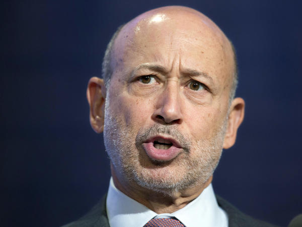 Goldman CEO Lloyd Blankfein, shown here at a September 2014 panel discussion, says he is pleased to resolve the allegations against the firm.