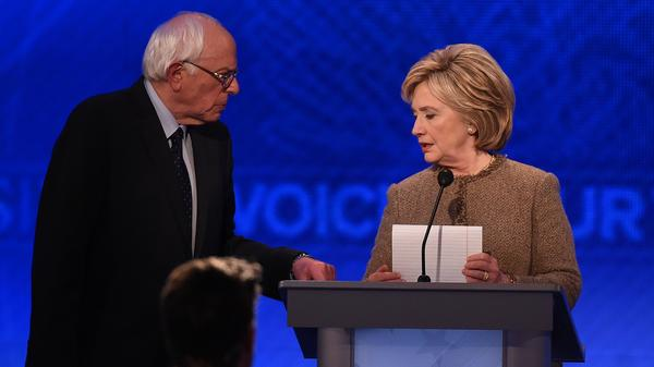 Bernie Sanders, left, and Hillary Clinton confer during a break in a December Democratic presidential debate in New Hampshire.