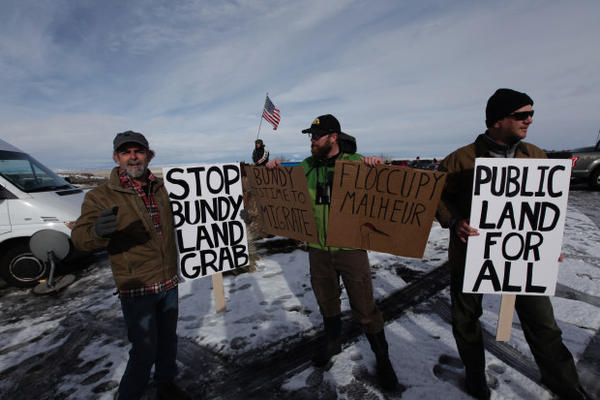 <p>Environmentalists hold signs supporting federal land management at the Malheur National Wildlife Refuge.</p>