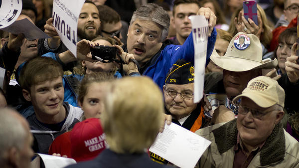 Republican presidential candidate Donald Trump (foreground), greets supporters after a rally last week in Iowa.