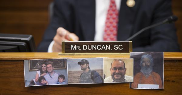 Congressman Jeff Duncan displays pictures of Saeed Abedini, Amir Hekmati, Jason Rezaian and Robert Levinson during a House Committee on Foreign Affairs hearing in Washington, D.C. on July 28, 2015. Abedini, Hekmati and Rezaian were freed this weekend as part of a prisoner swap; Levinson's location remains unknown.