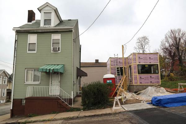 The new 330-square-foot tiny house sits next to a more conventional, neighboring house on N. Atlantic Avenue. The tiny house is being built on a lot that has been vacant for years. (Lou Blouin)