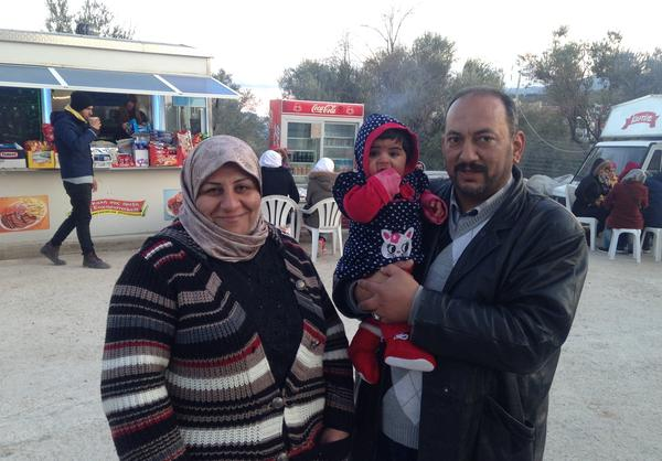"Firas Hassan Mohammad-Ali, his wife, Mithaq Abu-Al, and their 4-month-old daughter, Nargis, arrived by boat from Turkey to the Greek island of Lesbos earlier this week. Mohammad-Ali sheltered their daughter, who was wearing a tiny life jacket, inside his parka. ""I can swim,"" he says. ""I wanted to protect her from drowning and also from the cold."""