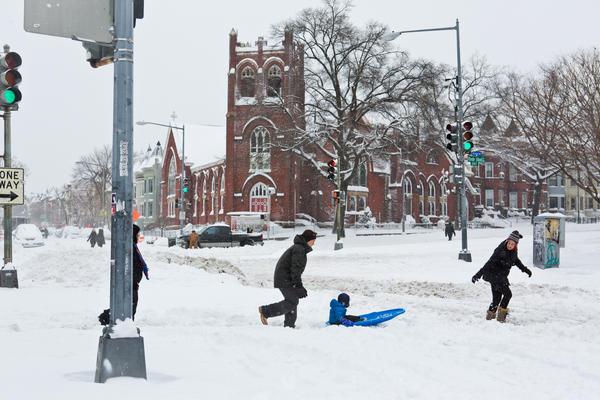 Residents take advantage of a break in the snow to wander down Rhode Island Avenue in Washington, D.C.