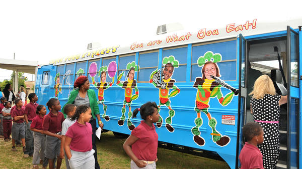 The Super Food Express bus travels to schools in Mobile County, Ala., to ensure children are fed healthy meals when school is out of session. The bus is part of the USDA's summer food program, which President Obama says needs additional funding.