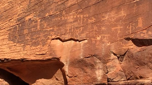 Gold Butte's red rock cliffs and slot canyons are home to many ancient petroglyphs. Some, like this one, have been shot at and damaged since federal land managers left the area due to safety concerns.