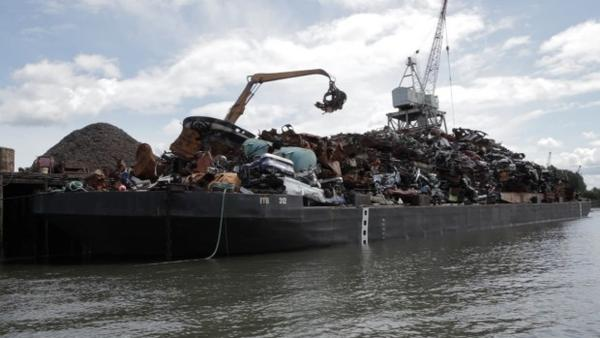 <p>File photo of a metal recycling operation on the bank of the Duwamish River. A cleanup plan announced Dec. 2, 2014 would spent $342 million from parties being held responsible for the river's pollution.</p>