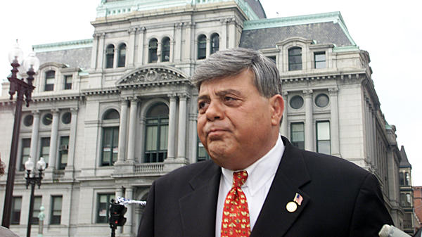 "Vincent A. ""Buddy"" Cianci in front of Providence City Hall in 2002, headed to the federal courthouse after being indicted on bribery and extortion charges. Cianci died Thursday at 74."