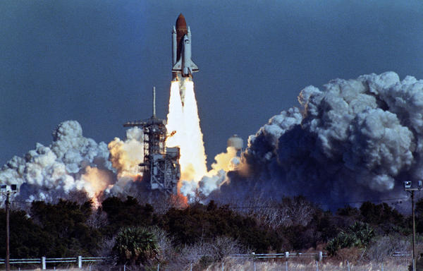 The Challenger lifts off on Jan. 28, 1986, from a launchpad at Kennedy Space Center, 73 seconds before an explosion killed its crew of seven.