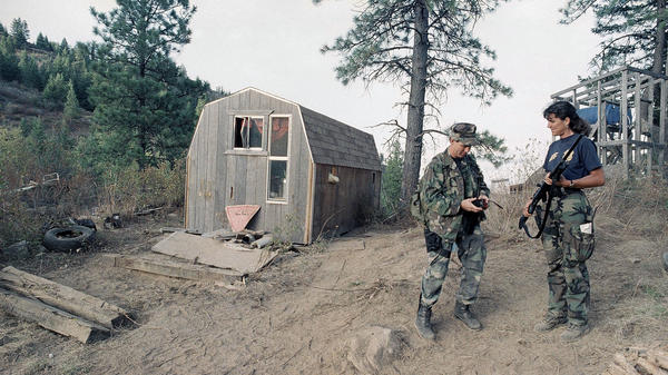 Agents with the Bureau of Alcohol, Tobacco and Firearms stand next to the outbuilding located near the Randy Weaver home near Naples, Idaho, in September 1992.