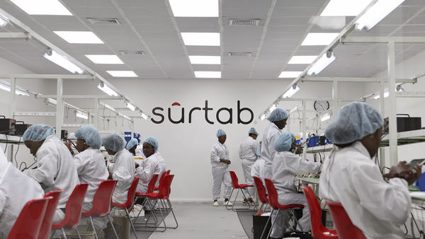 Workers assemble Android-based tablets from imported components at the Surtab factory in the Sonapi Industrial Park of Port-au-Prince.