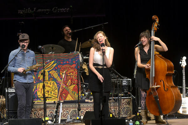 """The band is composed of vocalist Rachel Price, bassist Bridget Kearney, drummer Michael Calabrese and guitarist/horn player Mike """"McDuck"""" Olson."""