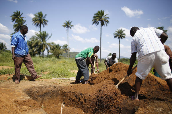 Guinea is where the Ebola outbreak started in West Africa. In this photo from November 2014, workers from the local Red Cross prepare to bury people who died of the virus.