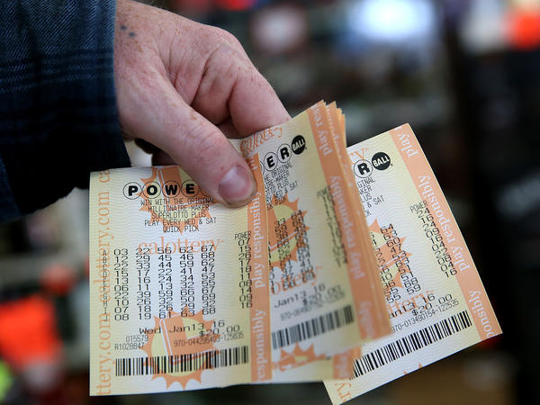 We know these are not the winning tickets. A customer holds a handful of Powerball tickets Wednesday at Kavanagh Liquors in San Lorenzo, Calif.