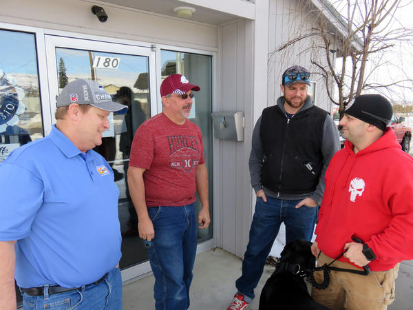 Alcoa smelter workers commiserate at their union hall in East Wenatchee, Washington; from left Kelley Woodard, Kirk Peterson, Clayton Verellen and Chris Morales.