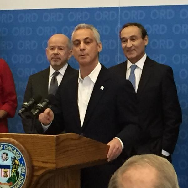 Chicago Mayor Rahm Emanuel announces an agreement to build a sixth runway at O'Hare International Airport, flanked by FAA Administrator Michael Huerta (left) and United Airlines President and CEO Oscar Munoz.
