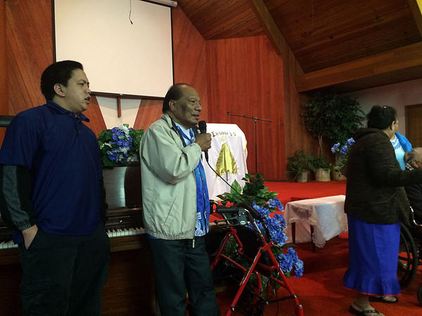 Jeik Irujiman leads a song during the offering at a Marshallese congregation in Salem.