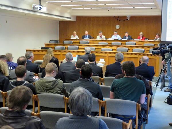 A capacity crowd observed a state Senate panel debate several minimum wage proposals Monday in Olympia.